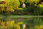 STOURHEAD LANDSCAPE GARDEN  WILTSHIRE: THE NATIONAL TRUST. MAY 2012 - PANORAMIC SUNSET VIEW ACROSS LAKE WITH REFLECTIONS AND TEMPLE OF APOLLO
