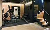 GARDEN DESIGNED BY  BUTTER WAKEFIELD  LONDON: BASEMENT GYM BY BASEMENT FORCE