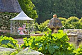 CHATEAU DU RIVAU  LOIRE VALLEY  FRANCE: THE CENTRAL COURTYARD AND POTAGER WITH FOUNTAIN AND MERRY GO ROUND BY PIERRE ARDOUVIN
