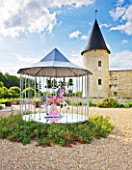 CHATEAU DU RIVAU  LOIRE VALLEY  FRANCE: THE CENTRAL COURTYARD WITH MERRY GO ROUND BY PIERRE ARDOUVIN AND CHATEAU BEHIND