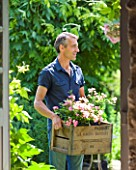 LES JARDINS DE ROQUELIN  LOIRE VALLEY  FRANCE: STEPHANE CHASSINE WITH A BOX OF ROSA THE FAIRY