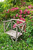 LES JARDINS DE ROQUELIN  LOIRE VALLEY  FRANCE: CHESTNUT WOODEN CHAIR BY STEPHANE CHASSINE WITH ROSA MARIA LISA