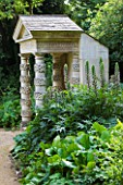 PAINSWICK ROCOCO GARDEN  GLOUCESTERSHIRE: FOLLY WITH ACANTHUS