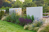 DEW POND HOUSE: DESIGN BY WILSON MCWILLIAM STUDIO - LAWN  RENDERED WALLS  STIPA TENUISSIMA  ERYNGIUM ALPINUM BLUE STAR  SALVIA CARDADONNA  KNIPHOFIA TAWNY KING  ACHILLEA