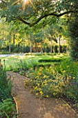 DEW POND HOUSE: DESIGN BY WILSON MCWILLIAM STUDIO - PATH TO LAWN AND DRIVEWAY - ACHILLEA TERRACOTTA  SALVIA CARADONNA  PERSICARIA AFFINE DARJEELING RED  BETULA NIGRA