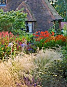 THE LAKE HOUSE: HOT BORDER BESIDE HOUSE WITH ACHILLEAS  STIPA  HELENIUMS AND CROCOSMIA