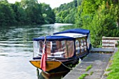 THE NATIONAL TRUST: CLIVEDEN  BUCKINGHAMSHIRE: BOAT BY THE BOAT HOUSE AND RIVER THAMES - AUGUST