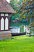 THE NATIONAL TRUST: CLIVEDEN  BUCKINGHAMSHIRE: BOAT BESIDE THE BOAT HOUSE BY THE RIVER THAMES