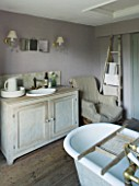 TWIG HUTCHINSON HOUSE  LONDON: BATHROOM WITH SINK AND CABINET - WOODEN LADDER AGAINST WALL