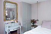 TWIG HUTCHINSON HOUSE  LONDON: BEDROOM WITH BED  DRESSING TABLE AND GOLD EDGED MIRROR