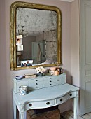 TWIG HUTCHINSON HOUSE  LONDON: BEDROOM WITH DRESSING TABLE AND GOLD EDGED MIRROR