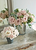 TWIG HUTCHINSON HOUSE  LONDON: METAL CONTAINERS ON SIDEBOARD WITH ROSES AND MIRROR BEHIND