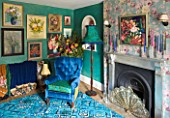 VELVET ECCENTRIC: NEW COUNTRY LOOK - BLUE RETRO CARPET  PERSIAN GREEN GLAZED WALLS  1930S GYPSY DOOR CURTAINS  FLORAL OIL PAINTINGS COLLECTED BY HANNAH BAUD  FIREPLACE AND LAMP