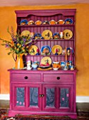 VELVET ECCENTRIC: HANNAH BAUDS LOUNGE. ORANGE WALLS GLAZED BY RACHEL BERGER. MAGENTA GLAZED DRESSER BY HANNAH BAUD  COLE AND SONS GONDOLA LUXURY WALLPAPER. CERAMICS