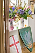 VELVET ECCENTRIC: GARDEN ROOM - JUGS IN WINDOWSILL WITH BIRD MOTIFS  WITH BLOOMS AND BERRIES: SHIELDS  BOUGHT AT AUCTION  WERE PROPS IN THE FILMS GLADIATOR AND A KNIGHTS TALE
