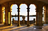 HEVER CASTLE  KENT  AUTUMN: THE ITALIAN GARDENS AT DAWN - LOOKING OUT TO THE LAKE FROM THE LOGGIA