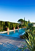 AFRICAN GARDEN  PROVENCE  FRANCE: DESIGNER DOMINIQUE LAFOURCADE: DECKING AND  WATER FOUNTAINS -  THE SWIMMING POOL
