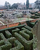 HAMPTON COURT CASTLE AND GARDENS  HEREFORDSHIRE: VIEW FROM THE GOTHIC TOWER ACROSS THE YEW MAZE TO THE WALLED GARDEN IN FROST WITH THE ISLAND PAVILIONS AND COURT BEHIND