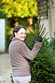THE GARDEN AND PLANT COMPANY  HATHEROP  GLOUCESTERSHIRE: EMILY TAKING HER TREE HOME FOR CHRISTMAS