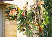 THE GARDEN AND PLANT COMPANY  HATHEROP  GLOUCESTERSHIRE: WREATHS & TIES MADE FROM NATURAL FOLIAGE  FRUITS  PHEASANT FEATHERS; FIR SPRIGS  HOLLY  ROSEMARY  CINNAMON STICKS