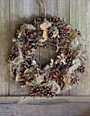 THE GARDEN AND PLANT COMPANY  HATHEROP  GLOUCESTERSHIRE: NATURAL WOODLAND TWIG WREATH WITH PINECONES  DRIED LEAVES  LICHEN