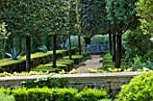 LA CASELLA, FRANCE: PATH, VISTA, CLIPPED, TOPIARY, MEDITERRANEAN, FRENCH, FORMAL, GREEN, EVERGREENS, SUMMER, PROVENCE, HEDGES, HEDGING, BOX, BUXUS, BLUE, SEAT, BENCH, AGAVES
