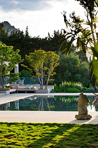 DESIGNER_JAMES_BASSON_SCAPE_DESIGN_FRANCE_SWIMMING_POOL_WITH_LAGERSTROEMERIA_INDICA_TREE__ZOYSIA_TEN
