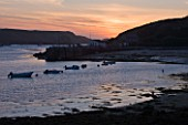 THE ISLES OF SCILLY: THE HARBOUR AT TRESCO AT SUNSET
