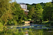 GLYNDEBOURNE, EAST SUSSEX: VIEW ACROSS THE LAKE TO THE OPERA HOUSE - WATER, LANDSCAPE