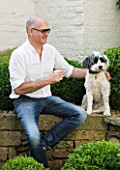 RICHARD CARNILL HOUSE  NOTTINGHAMSHIRE: RICHARD CARNILL  FOUNDER OF CARNILL & COMPANY DECORATIVE INTERIORS AND ANTIQUES  WITH DOG BEARDED COLLIE CROSS CHICO