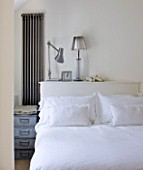 RICHARD CARNILL HOUSE  NOTTINGHAMSHIRE: MASTER BEDROOM IN FARROW AND BALL POINTING  WALL ART BY LAM TUNG PANG  LINEN CUSHIONS CARNILL & COMPANY  ANGLE POISE LAMP BY FLOS