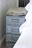 RICHARD CARNILL HOUSE  NOTTINGHAMSHIRE: MASTER BEDROOM: ZINC CRATES FROM BAILEYS HOME AND GARDEN. WOOL THROW FROM CARNILL & COMPANY