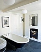 RICHARD CARNILL HOUSE  NOTTINGHAMSHIRE: BATHROOM WITH CAST IRON BATH  SLATE FLOOR  RADIATOR BY BISQUE. MIRROR JOHN LEWIS. WALLS PAINTED IN FARROW AND BALL POINTING