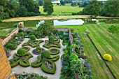 BROUGHTON CASTLE, OXFORDSHIRE: THE LADIES GARDEN SEEN FROM THE TOP OF THE CASTLE - PARTERRE, FLEUR DE LYS, TOPIARY, BOX, TRIMMED, CLIPPED, SUMMER GARDEN, ENGLISH GARDEN