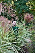 CHATEAU DE CHENONCEAU  FRANCE: FLORIST DAVID HOGUET PICKS MISCANTHUS FOR A FLOWER DISPLAY IN THE CHATEAU IN THE POTAGER/ CUTTING GARDEN  MORNING LIGHT