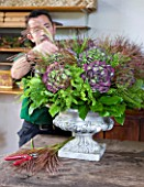 CHATEAU DE CHENONCEAU  FRANCE: FLORIST DAVID HOGUET MAKES A FLORAL ARRANGEMENT FOR THE CHATEAU FROM HYDRANGEAS AND GRASSES CUT FROM THE CUTTING GARDEN