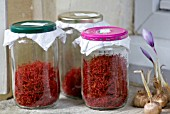 DOMINIQUE BLANCHARD SAFFRON FARM  LOIRE VALLEY FRANCE: SAFFRON MATURING IN JAM JARS ON WINDOWSILL