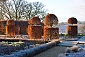 BROUGHTON GRANGE, OXFORDSHIRE: DESIGNER TOM STUART - SMITH: CLIPPED TOPIARY BEECH HEDGES IN FROST IN THE WALLED GARDEN. WINTER, COUNTRY GARDEN, TRIMMED, EVERGREEN