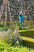 ARUNDEL CASTLE GARDENS  WEST SUSSEX: THE COLLECTOR EARLS GARDEN: THE ORGANIC KITCHEN GARDEN WITH BORAGE AND SCARECROWS