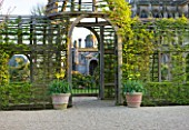 ARUNDEL CASTLE GARDENS, WEST SUSSEX: THE COLLECTOR EARLS GARDEN; OAK PERGOLA - DESIGNED BY JULIAN AND ISABEL BANNERMAN