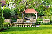 ARALIA GARDEN DESIGN - PATRICIA FOX: WEDNESDAY HOUSE: LAWN, HEDGE, TREE SEAT, STONE WALLS AND WOODEN LOGGIA