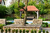 ARALIA GARDEN DESIGN - PATRICIA FOX: WEDNESDAY HOUSE: HEDGE, TREE SEAT, STONE WALLS AND WOODEN LOGGIA