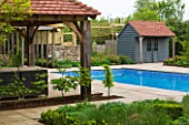 ARALIA GARDEN DESIGN - PATRICIA FOX: WEDNESDAY HOUSE: WOODEN LOGGIA, SWIMMING POOL AND POOL HOUSE