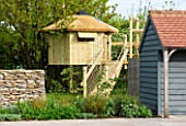 ARALIA GARDEN DESIGN - PATRICIA FOX: WEDNESDAY HOUSE: POOL HOUSE, STONE WALL AND TREE HOUSE