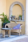 SICILY  ITALY: CASA CUSENI IN TAORMINA - MARBLE TERRACE / PATIO WITH WICKER SEAT / BENCH AND TABLE AND CUSHION - A PLACE TO SIT