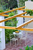 SICILY  ITALY: CASA CUSENI IN TAORMINA - METAL TABLE AND CHAIRS ON PATIO WITH NEW PERGOLA - SHADE  ENTERTAINING  ENTERTAIN  FOOD  EATING  DINING  MEDITERRANEAN