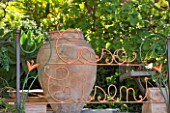 SICILY  ITALY: CASA CUSENI IN TAORMINA - CASA CUSENI WRITTEN IN THE GARDEN RAILINGS  BEHIND A LARGE TERRACOTTA URN WHICH KITSON WAS FOND OF FILLING WITH PLANTS