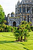 ARUNDEL CASTLE GARDENS, WEST SUSSEX: THE COLLECTOR EARLS GARDEN: TRACHYCARPUS FORTUNEI ON THE LAWN - DESIGNED BY JULIAN AND ISABEL BANNERMAN