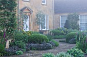 ROCKCLIFFE HOUSE, GLOUCESTERSHIRE: THE  - GREEN, COUNTRY GARDEN, ROMANTIC, MIST, FOG - TERRACE / PATIO WITH FOXGLOVES, SAGE AND ALCHEMILLA MOLLIS
