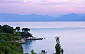 CORFU, GREECE - THE KASSIOPIA ESTATE. VIEW OUT TO SEA WITH ALBANIAN MOUNTAINS IN THE DISTANCE